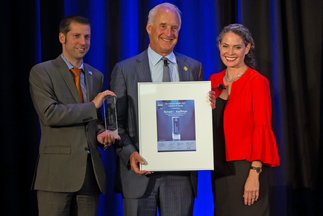 Richard L. Kauffman receives the Champion of Change AWARD from Bernadette del Chiaro (Executive Director, CALSEIA) and Dr. Florian Wessendorf (Managing Director Solar Promotion International GmbH)